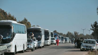 بدء تنفيذ اتفاق حي الوعر بحمص بخروج المسلحين: