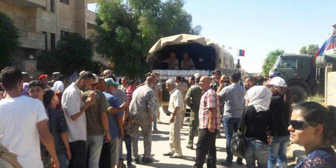 توزيع مساعدات إنسانية من روسيا والهلال الأحمر على أهالي دير الزور
